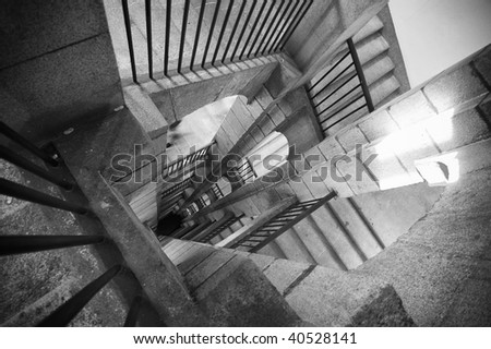 A black and white stair with shadows and light - stock photo