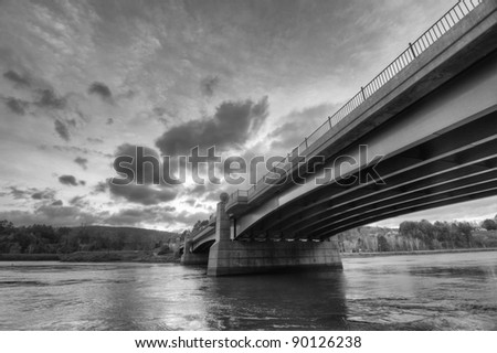 A Black and White View from Underneath a Bridge