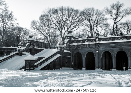 A black and white view of Bethesda Terrace after a snowfall. - stock photo