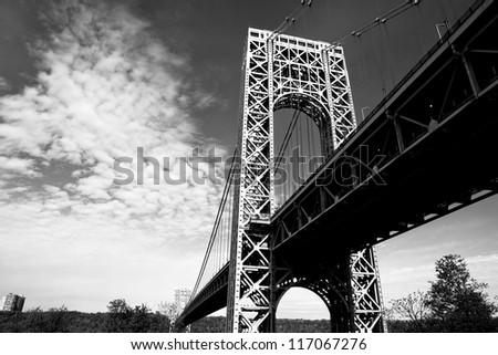 A black and white view of the New York City George Washington Bridge as seen from below. - stock photo