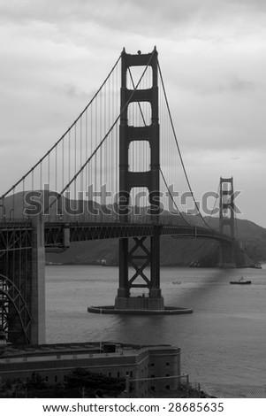A black and white view of the San Francisco Golden Gate Bridge - stock photo