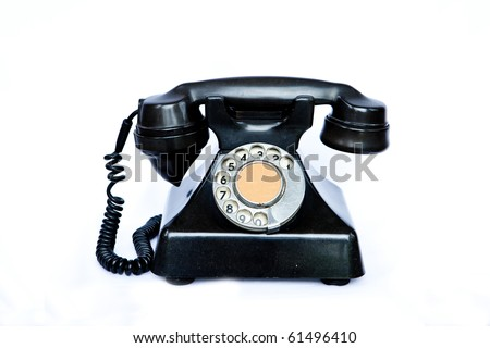 A black antique telephone used in the 50's. - stock photo