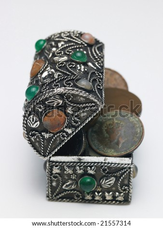 A black box with scattered coins - stock photo