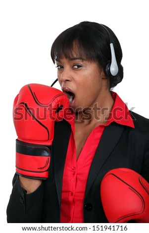 A black businesswoman yawning - stock photo