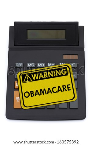 A black calculator with ObamaCare warning sign isolated on a white background, Costs of ObamaCare - stock photo