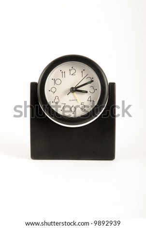 A black clock on isolated white