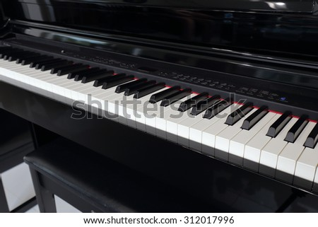 A black electronic piano with piano keys