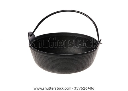 A black iron pan(pot, saucepan) with iron handle side view isolated white.