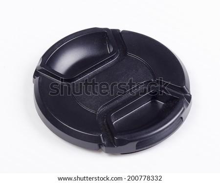 A black isolated camera lens cap - stock photo