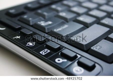 A black keyboard with internet,email,and help sign. - stock photo
