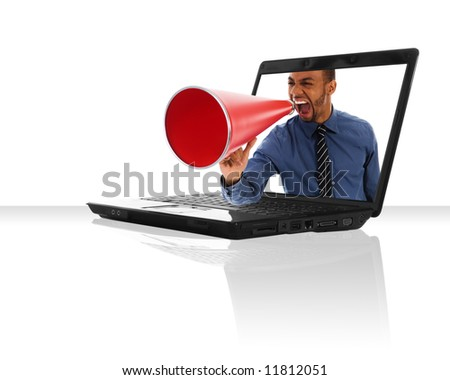 a black laptop computer with a red megaphone - stock photo