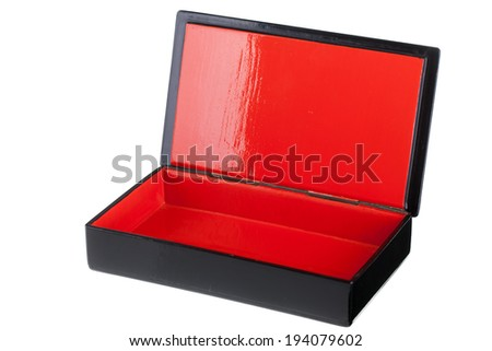 a black laquered box with a bright red interior isolated over white - stock photo