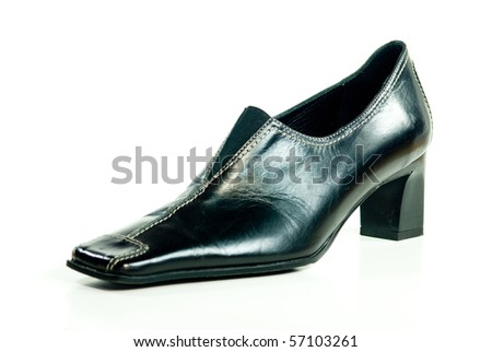 A black leather shoe - stock photo