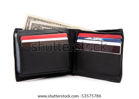 A black leather wallet with a few dollars and a bunch of credit cards isolated over white. - stock photo