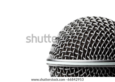 A black microphone isolated on a white background - stock photo