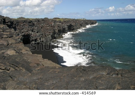 A black sand beach near Volcanoes National Park on the Big Island of Hawaii. - stock photo
