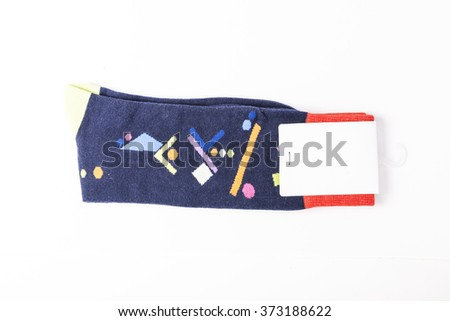 A black socks with empty(blank) label, graphic pattern on the bottom isolated white.  - stock photo
