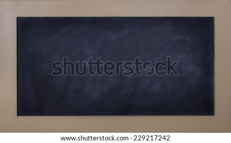 A blank black chalkboard with wooden frame - stock photo