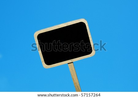a blank blackboard label isolated on a blue background - stock photo