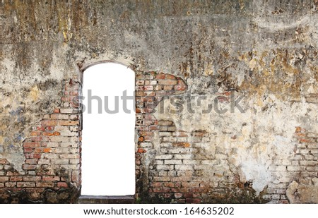 A blank doorway on a grungy decaying brick wall.  - stock photo