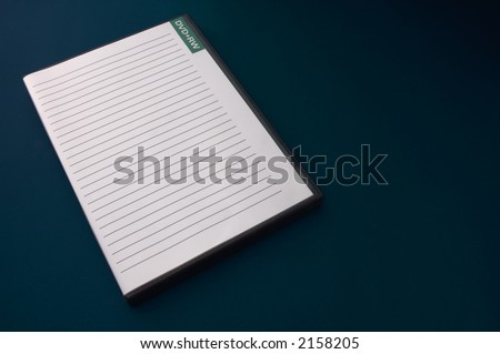 A blank DVD case on dark background - stock photo