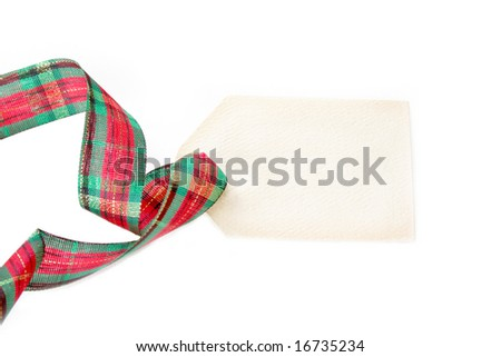 A blank gift tag with christmas ribbon.  Isolated on a white background
