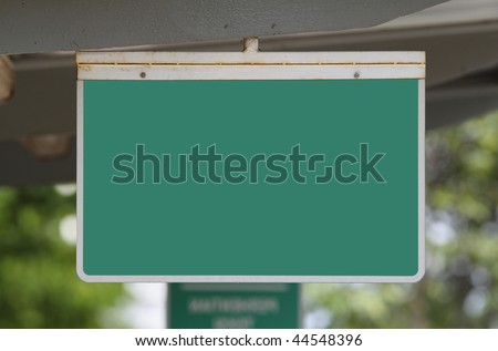 A blank green sign at a bus stop - stock photo