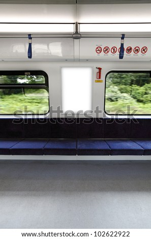 A blank lighted signboard inside a high speed train, with space for text. - stock photo