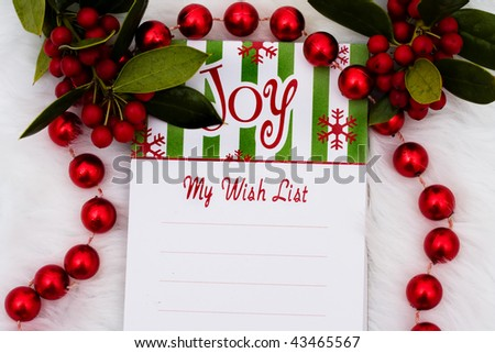 A blank notepad with the word joy on a white fur background