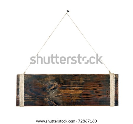 A blank piece of wood hanging from a nail - stock photo