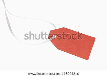 A blank, red christmas gift tag, includes clipping path