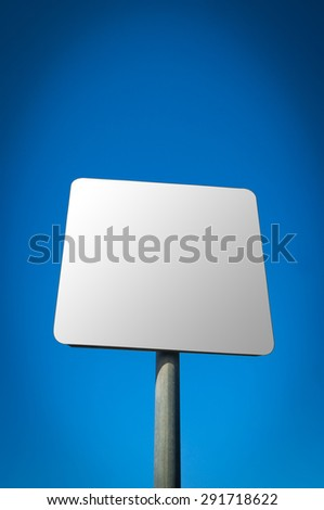 A blank road sign isolated on a blue  sky. - stock photo