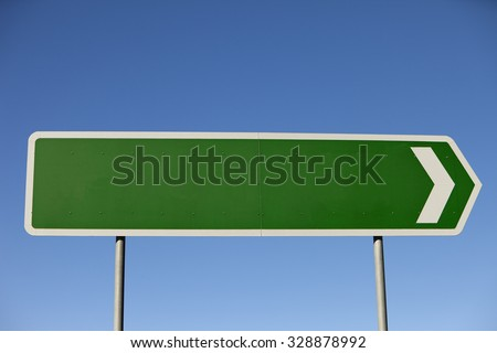 A blank road sign set against perfect blue sky pointing to right of frame, flip image to point to left, lots of copy space inside and outside of the sign.  Shot with a Canon 5d mk2 in rural Australia. - stock photo