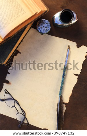 A blank sheet of paper and quill - stock photo