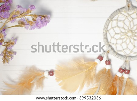 A blank sheet of paper, dream catcher, and dried flowers, keeping a dream journal (dream diary) concept, bright toned photo, top view, copy space, selective focus on a dream catcher - stock photo