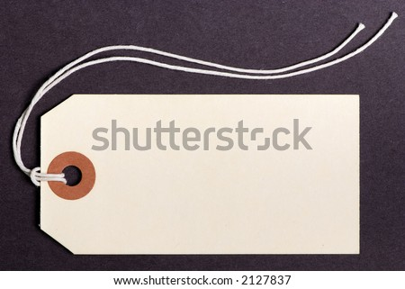 A blank tag on a brown background... name your price.