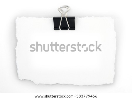 A blank white note with a clip, on a light grey background. - stock photo