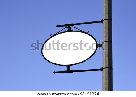 A blank white sign mounted to a pole. - stock photo