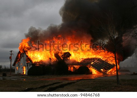A blazing inferno shows why fire is so destructive.  This house burned to the ground in less then an hour from the fire's start. - stock photo