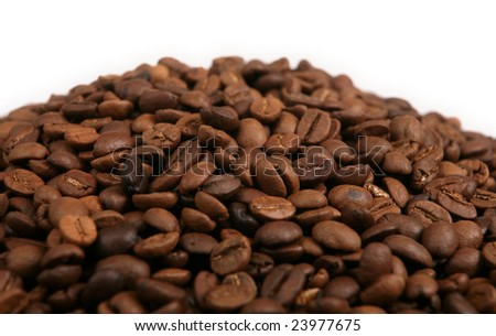 A blend of roasted coffee beans in a heap