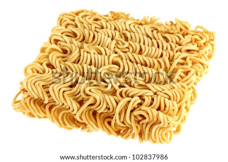 A block of dried Instant noodles isolated on a white background - stock photo