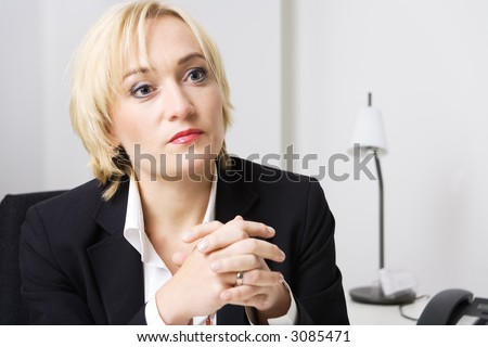 A blond business woman simply listening