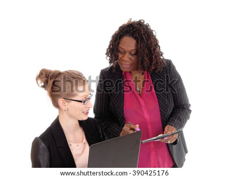 A blond Caucasian and an African American woman in a closeup