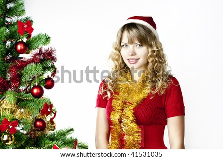 A blond girl in christmas hat - stock photo
