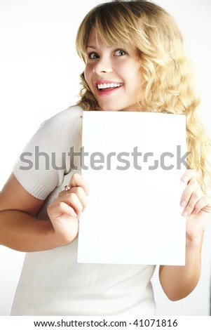 A blond young woman showing a paper - stock photo