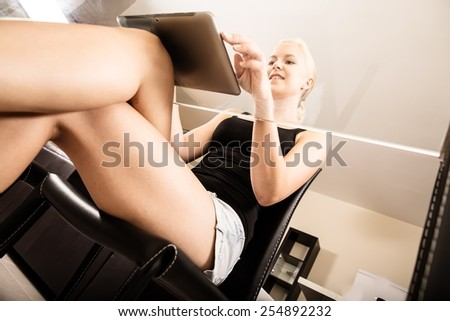 A blonde girl talking with a smartphone. - stock photo