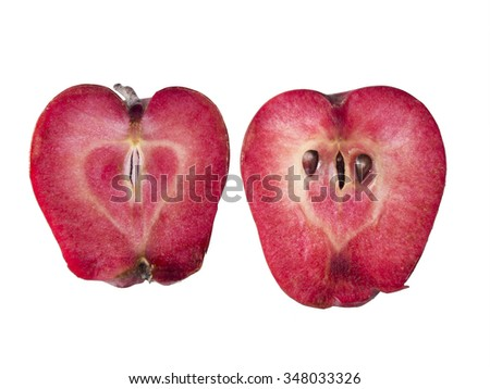 A blood red apple variety comes from an heirloom apple tree in a remote orchard on Waldron Island in Washington State. - stock photo