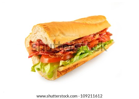 A BLT Sub roll made with Bacon, lettuce, tomato and mayo in a french bread roll - stock photo