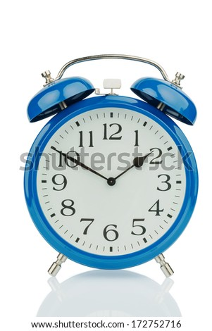 a blue alarm clock on white background. a wake white dial