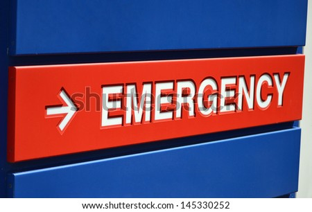 A blue and red Emergency sign outside a hospital